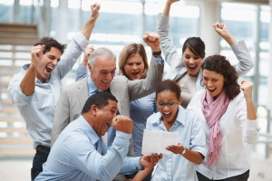 Business team celebrating over finalization of a contract
